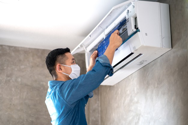 technician-man-repairing-cleaning-maintenance-air-conditioner